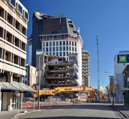 deemed: Christchurch, New Zealand - May 27, 2012: The last days of the Grand Chancellor Hotel building. Previously the tallest building in Christchurch at 85 metres and now only the bottom five floors remain to be demolished. The hotel was deemed unsafe and has b
