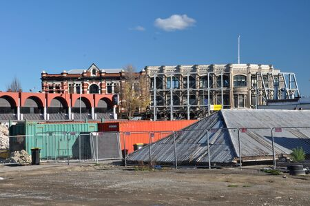 willis: Christchurch, New Zealand - May 27, 2012: A massive steel frame assists in the conservation of the historic and iconic McKenzie & Willis building facade on the corner of St Asaph and High Streets. The building was severely damaged in recent earthquakes an Editorial