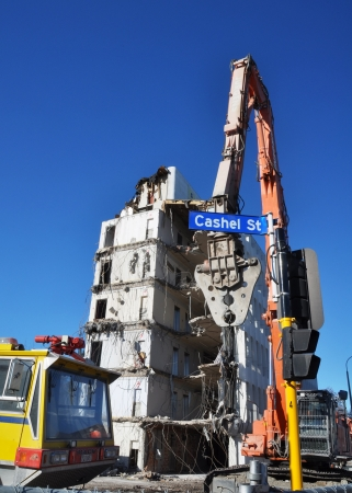 christchurch: Christchurch, New Zealand - May 20, 2012: Powerful equipment is being used to tear down high rise buildings in Christchurch after thousands of earthquakes devastated the city. Editorial
