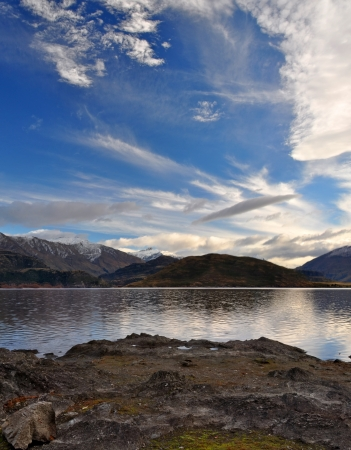 A vertical panoramic view of Mount Aspring in the background  In the foreground are the shores of Lake Wanaka  Central Otago, New Zealand  Plenty of copy space available  photo
