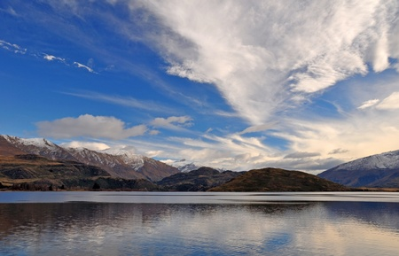 A landscape view of Mount Aspring and norwest cloud formations  in the background  In the foreground is Lake Wanaka  Central Otago, New Zealand  Plenty of copy space available  photo