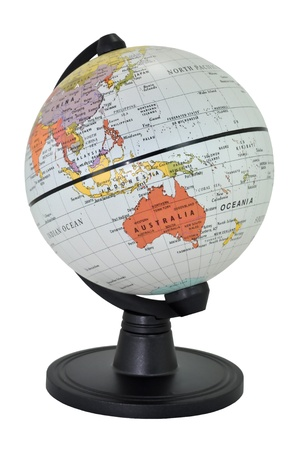 Isolated world globe with black stand on a white background, Focusing on Australia. Stock Photo