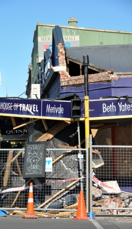 cordoned: Christchurch, New Zealand - September 07, 2010: Travel agency on Papanui Road in Christchurch is demolished by a 7.1 Earthquake. Typical of old brick structures - the front of the building has collapsed onto the footpath. The building has been cordoned of