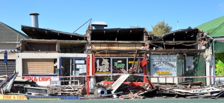 quake: Christchurch, New Zealand - September 05, 2010: Two take-out  food shops and a hairdressing salon are destroyed by the biggest quake Christchurch has ever experienced.
