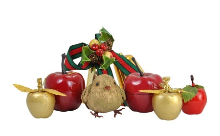 Christmas border or frieze design with apples, a bird and bells  isolated on a white background. Stock Photo - 14569763