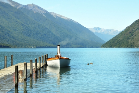 nelson: Steam boat and jetty on Lake Rotoiti in the Nelson Lakes District of the South Island, New Zealand   Stock Photo