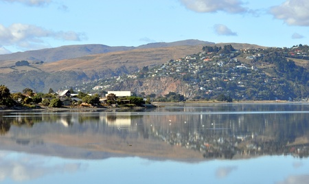 christchurch: A panorama of Christchurch estuary in the foreground with the hill suburb of Redcliffs in the background. The estuary is safe haven and breeding ground for migratory birds from all over the world. Stock Photo