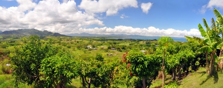 Panoramic view of the Fijian west coast. In the background the town of Nadi and Denarau Island. Stock Photo
