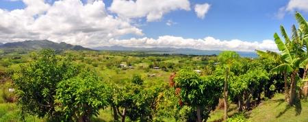 fiji: Panoramic view of the Fijian west coast. In the background the town of Nadi and Denarau Island. Stock Photo