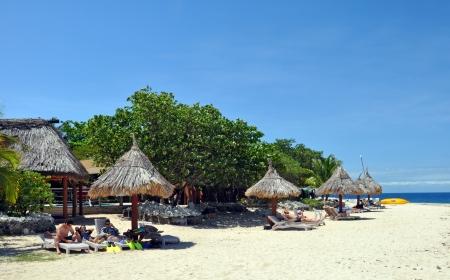 South Sea Island, Fiji - October 01, 2012: Tourists enjoy the Spring sunshine at South Sea Island, Fiji.