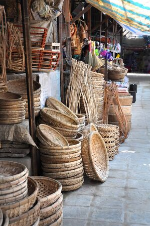 Cane basket and tray shop at the Hoi An market, Vietnam