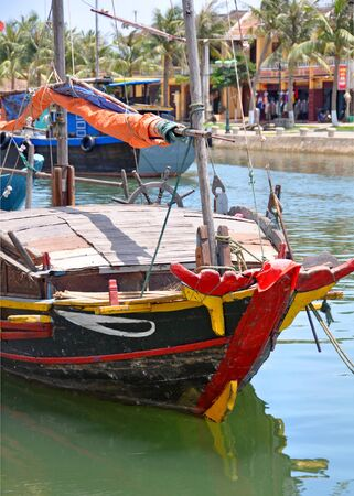 enables: A traditional Vietnamese fishing boat on the Hoi An River. Note the eye on the bow which  enables the boat to return safely to harbour.
