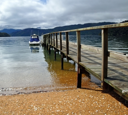 marlborough: Dartmoor Bay Jetty   Boat in the Marlborough Sounds of New Zealand