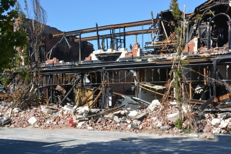 christchurch: The remains of the MzKenzie   Willis building in High Street after a series of devastating earthquakes and a recent fire in Christchurch, New Zealand