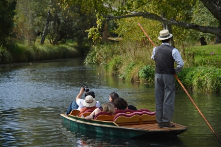 boatman: Christchurch, New Zealand - March 31, 2013: A boatman guides a group of tourists in their punt down the Avon River on Easter Sunday afternoon. Editorial