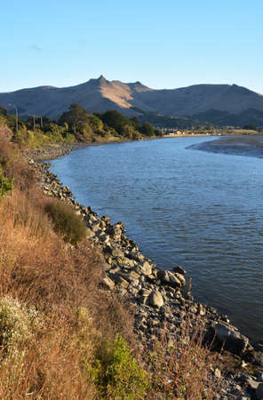 christchurch: Heathcote River and Port Hills at Sunset, Christchurch, New Zealand Stock Photo