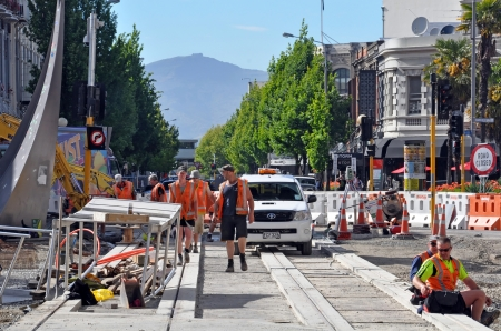 christchurch: Christchurch, New Zealand - November 11, 2010: Construction workers building new tram tracks on the intersection of Lichfield and High Streets following recent earthquakes on November 11, 2010 in Christchurch. Editorial