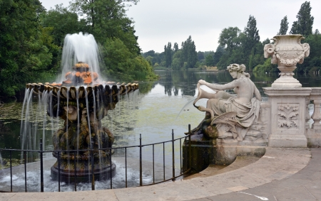 italian fountain: Fountain and statue in the Italian Gardens, Hyde Park, London UK  In the background is the Serpentine