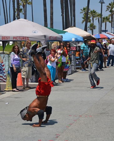 Los Angeles, USA - July 14, 2013  Acrobat on Venice Beach Entertains the weekend Visitors,California, USA