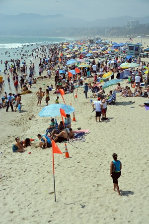 Los Angeles, USA - July 14, 2013  Thousands of locals and tourists flock to Santa Monica beach on a hot Summer day