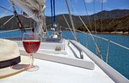 Summer Luxury - a glass of Rose and a Panama hat on the deck of a yacht in the Marlborough Sounds, New Zealand  photo
