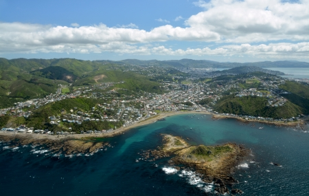 wellington: Aerial View of Wellington City from Island Bay  In the foreground are the southern suburbs with the city and harbour in the background  Stock Photo