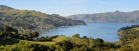 christchurch: Panoramic view of Akaroa township - one of New Zealands most popular tourist and cruise boat destinations. Stock Photo