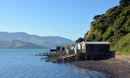 christchurch: Boat Houses on the shores of Akaroa Harbour, New Zealand.