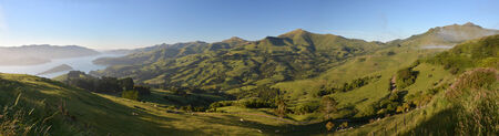 Panoramic view of beautiful Akaroa Harbour from the Summit Road at Dawn, Canterbury New Zealand photo