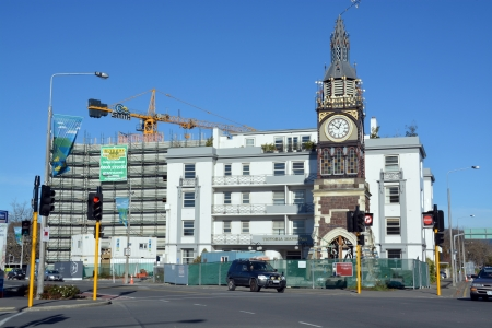 Christchurch, New Zealand - June 08, 2013  Christchurch Earthquake Rebuild - The iconic Diamond Jubilee Clock Tower awaits its turn for repair while in the background a new seven story office block takes shape in Victoria Street  Note the clock is stuck o