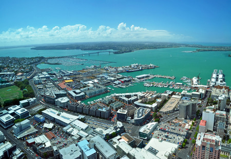 Panoramic aerial view of Auckland City    Waitemata Harbour looking northwest to the  iconic Auckland Harbour Bridge in the distance  In the foreground is the popular Viaduct Basin entertainment area and over 135,000 yachts and power boats in several mari Stock Photo