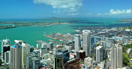 Auckland, New Zealand - December 02, 2011  Auckland city   harbour landscape aerial panorama looking east to Rangitoto Island and the heads of the Waitemata Harbour In the foreground are the buildings of the Central business district
