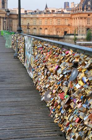 stone bridge: Paris, France - July 23, 2013: Closeup view of the hundreds of thousands of love inscribed padlocks on the Pont Des Arts Bridge.