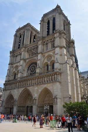 ile de la cite: Paris, France - July 23, 2013: Visitors at the entrance to Notre Dame Cathedral, Paris France.