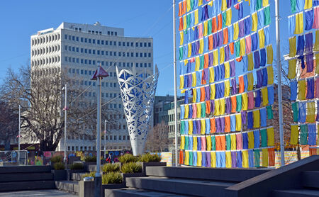 recently: Christchurch, New Zealand - June 15, 2014  Artworks in Cathedral Square include the Chalice by Neil Dawson and recently erected Flag Wall by Sara Hughes