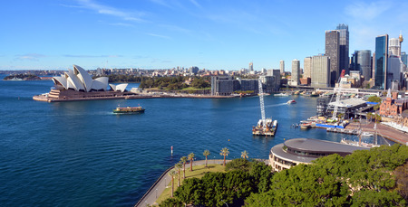 quayside: Sydney, Australia - July 18, 2014:  Sydney Harbour, Circular Quay & Opera House Panorama taken from the top of the Harbour Bridge.