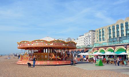 brighton beach: Brighton, United Kingdom - September 28, 2014: Carousel on the beach on a Summer day at Brighton on the south coast of England.