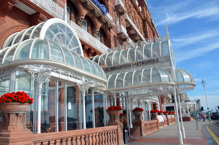 brighton beach: Brighton, United Kingdom - September 28, 2014: Metropole Hilton Hotel entrance in summer sunshine in Brighton, England.