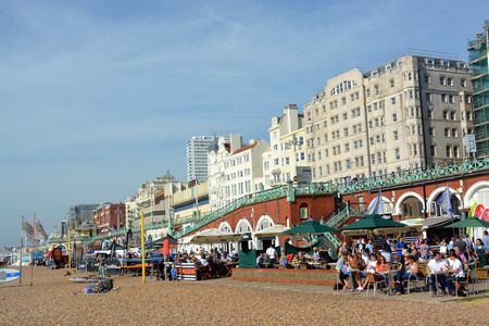 brighton beach: Brighton, United Kingdom - September 28, 2014: A busy lunchtime crowd on a summer day at the restaurants on Brighton Beach. Editorial