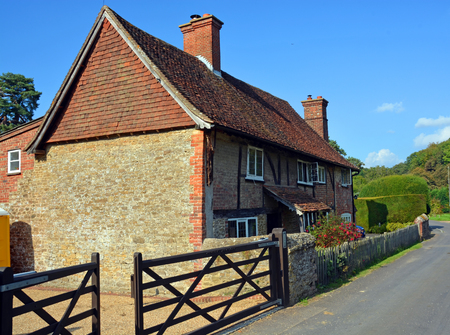 storied: Traditional two storied Hascombe Farm house in Surrey made from local stone and bricks.
