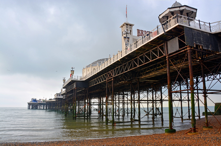 brighton beach: Brighton, United Kingdom - September 30, 2014: View of Brighton Pier from underneath including steel piles and structure.