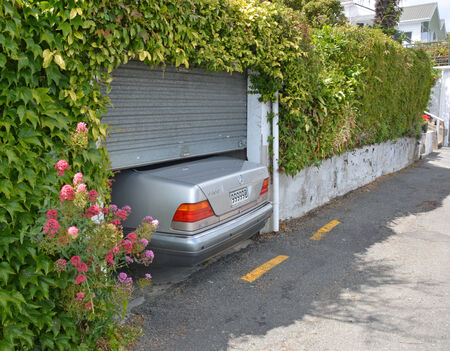 car in garage: Nelson, New Zealand - November 30, 2014:  Parking is at a Premium on Nelson