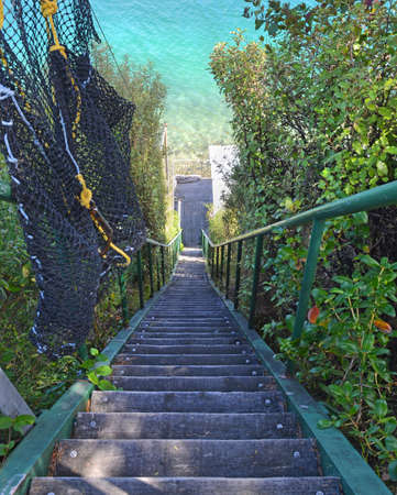 sounds: Steep wooden steps down to paradise - the treacherous route to a a batch in the Marlborough Sounds, New Zealand. Stock Photo