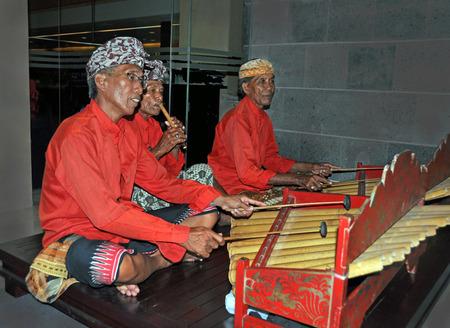 gamelan: Bali, Indonesia - February 15, 2012: Gamelan Jegog Trio Performing in Bali, Indonesia.