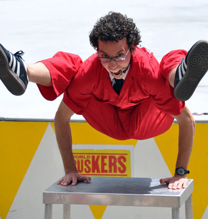 contortion: Christchurch, New Zealand - January 29, 2011: Combining comedy, contortion and stunts, Jonathan Burns from the USA performs at the 18th World Buskers Festival.