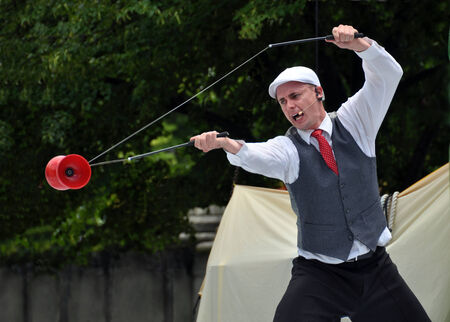 asher: Christchurch, New Zealand - January 22, 2011: Australian performer Asher Treleaven juggling a red Diablo at the at the 18th World Buskers Festival. Editorial
