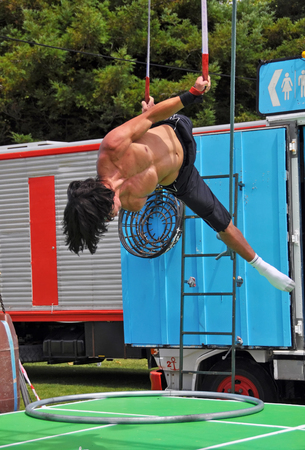 comedic: Christchurch, New Zealand - January 21, 2013: Fuse Circus performer practicing before the Campground Chaos show at the 20th World Buskers Festival on January21, 2013 in Christchurch. Editorial