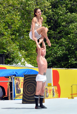 comedic: Christchurch, New Zealand - January 22, 2013: Acrobats Mim and Danny perform at the 20th World Buskers Festival on January22, 2013 in Christchurch.