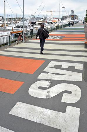 pedestrian walkway: Auckland, New Zealand - August 04, 2015: Popular tourist pedestrian walkway in the Viaduct Basin boat harbour.