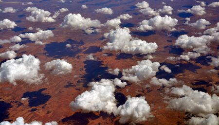 aerial: Aerial view from 35,000 feet of Tallaringa Desert and clouds pattern in South Australia Stock Photo